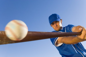Batter Hitting Baseball --- Image by © Royalty-Free/Corbis
